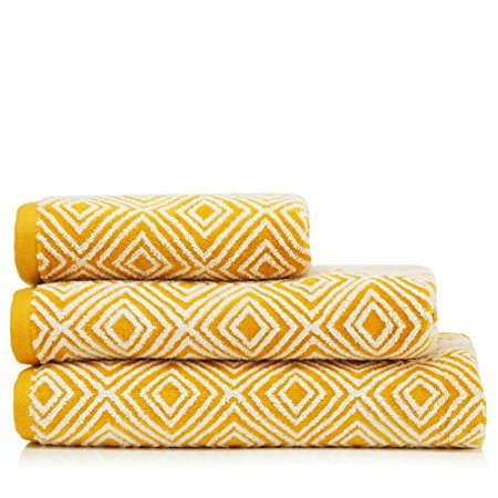 When did you last update your bathroom towels? If they're lost their original softness from heaps of wear, why not update them with some fluffy new towels? We love these dark yellow diamond design towels from J by Jasper Conran.