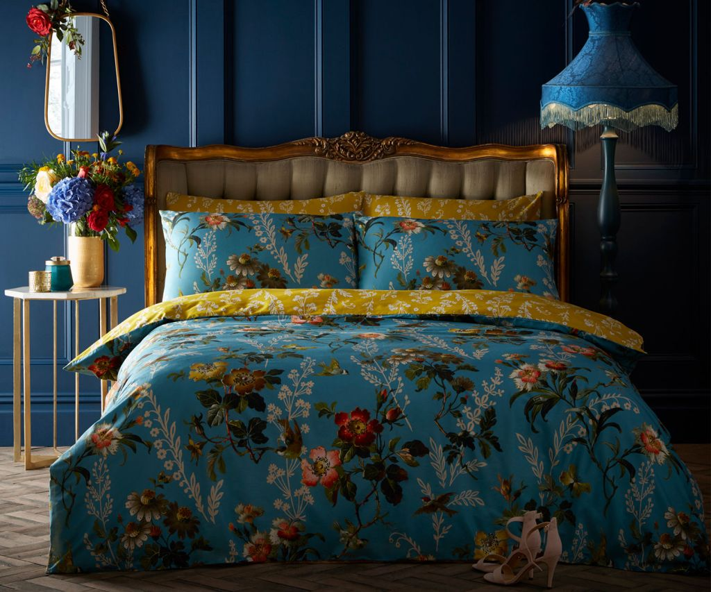 Transform your bedroom into a botanical haven with this rich teal and ochre duvet set