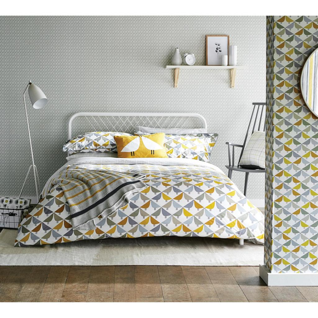 On trend yellow bedding with a cute graphic bird design
