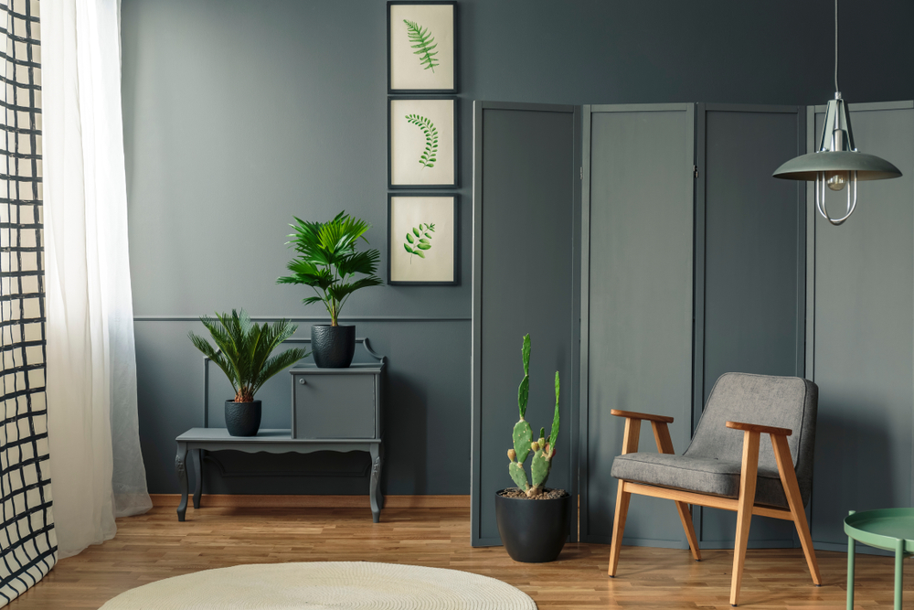 Divide your interior space with ease by using a room divider screen