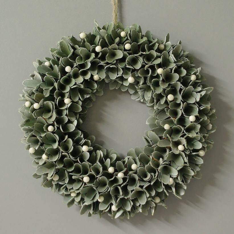 Add some seasonal cheer to your front door by hanging this mistletoe wreath
