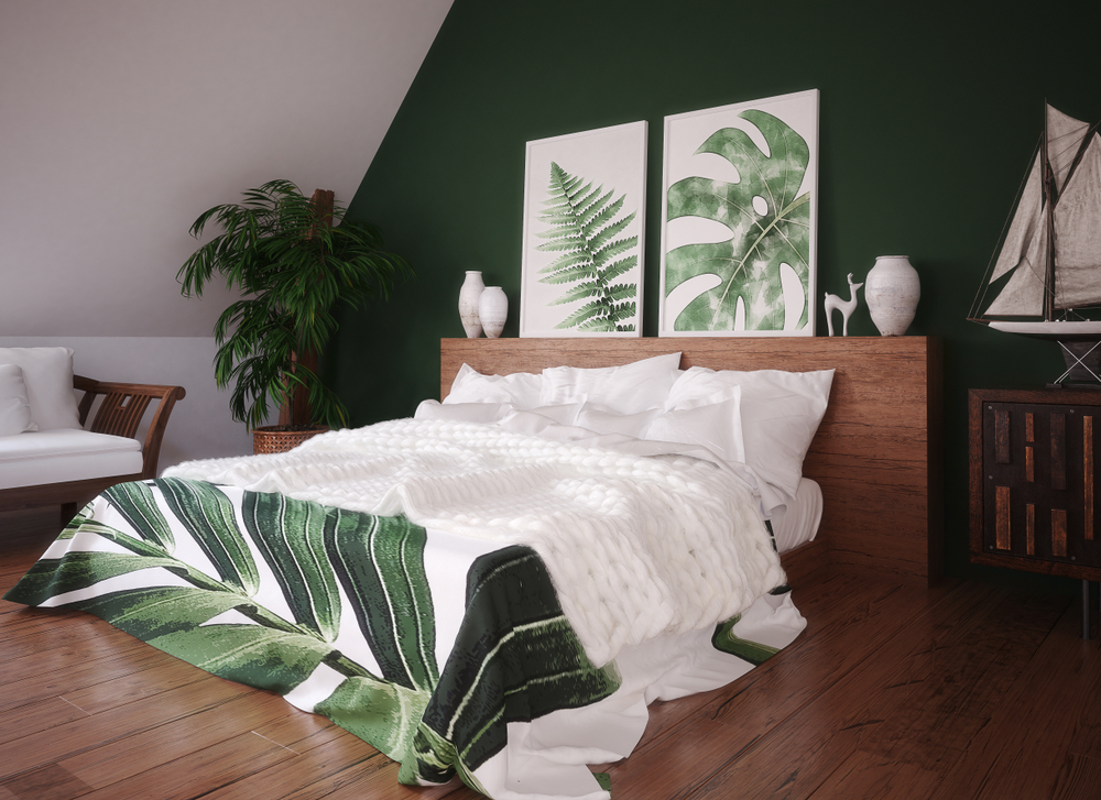 A nice idea for how to style a loft conversion, using a dark green feature wall and wooden flooring