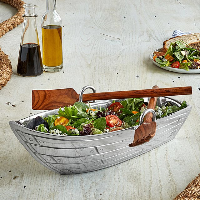 Love this quirky rowing boat design serving bowl - it even has utensils that are styled as oars!