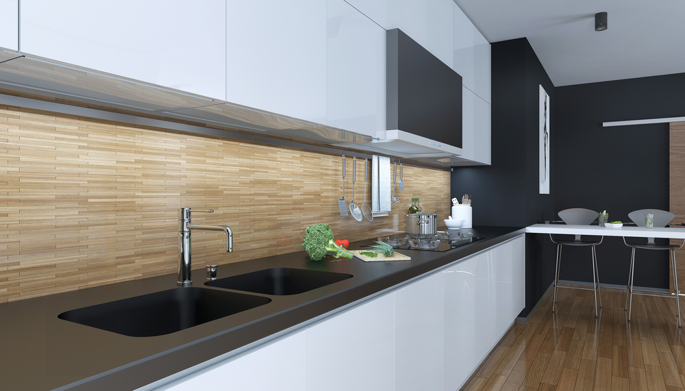There are heaps of benefits of using laminate flooring. Here it's used to great effect in a stunning modern kitchen
