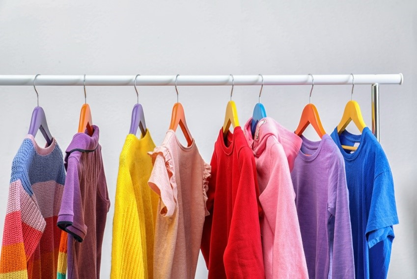 If a bedroom has limited space, use clothing rails instead of a wardrobe