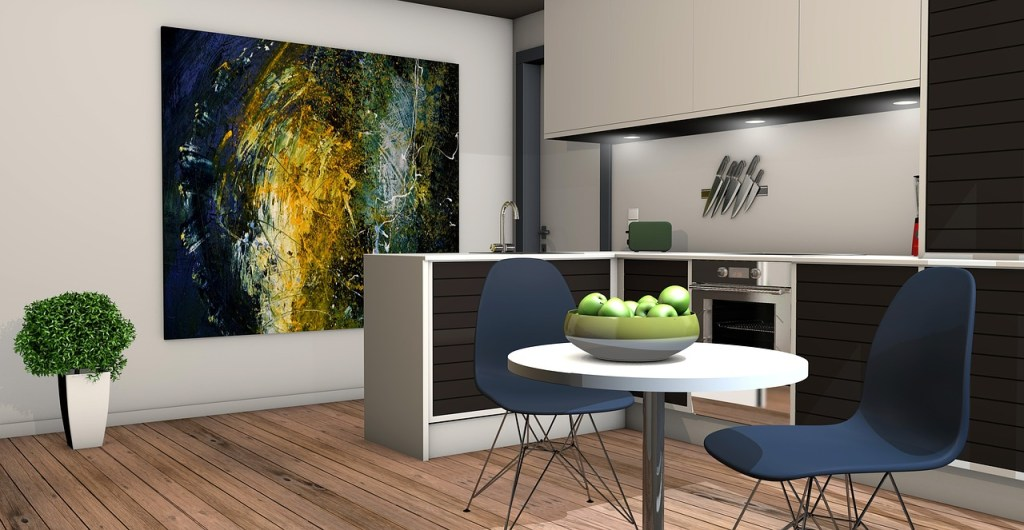 Open plan apartment that uses a kitchen island and an eye-catching piece of artwork to delineate space