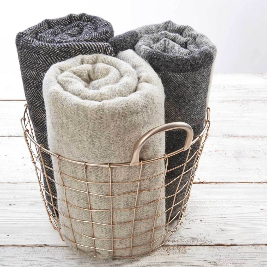 Add some autumn style to your bedroom by using warm wool throws on your bed