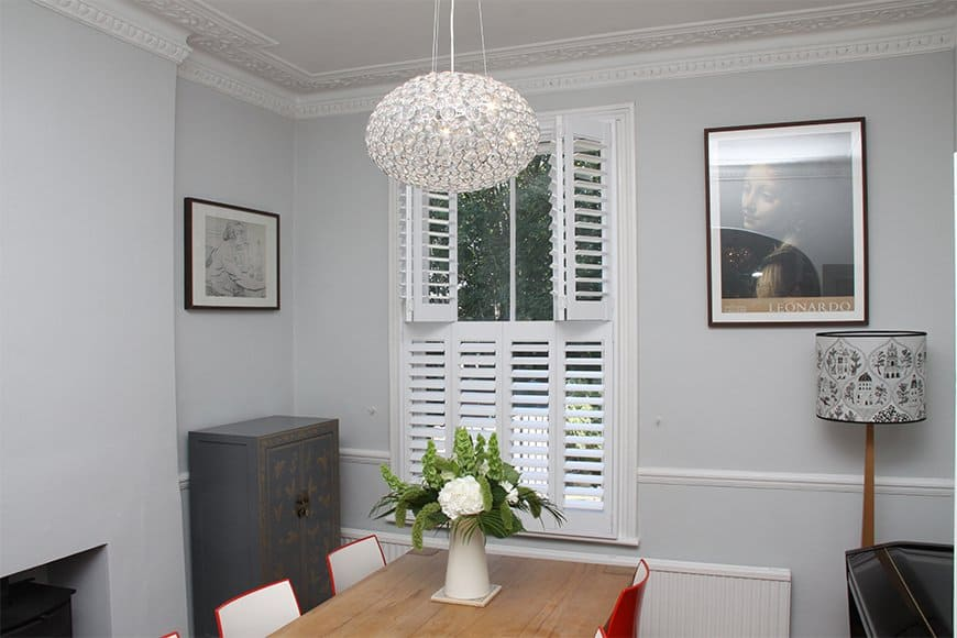 A lovely example of the functionality of interior window shutters