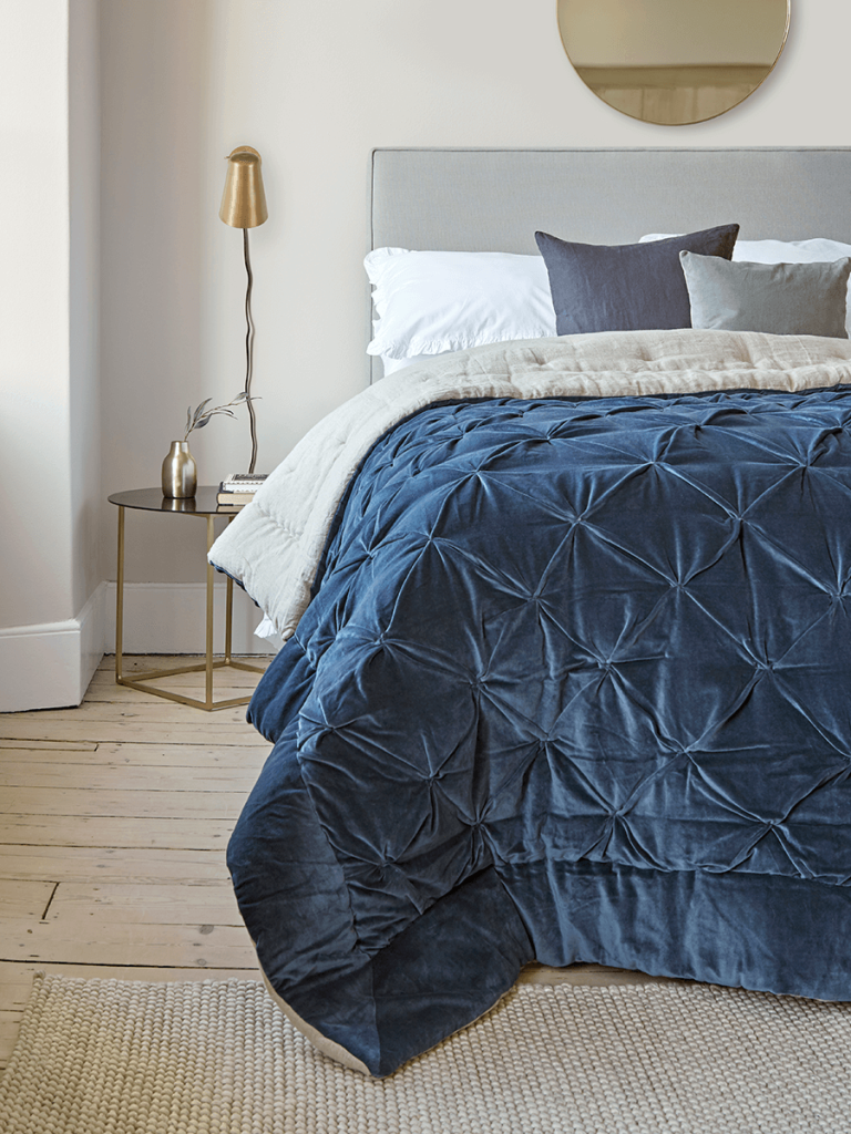 Gorgeous classic blue colour velvet quilt for a luxury bedroom