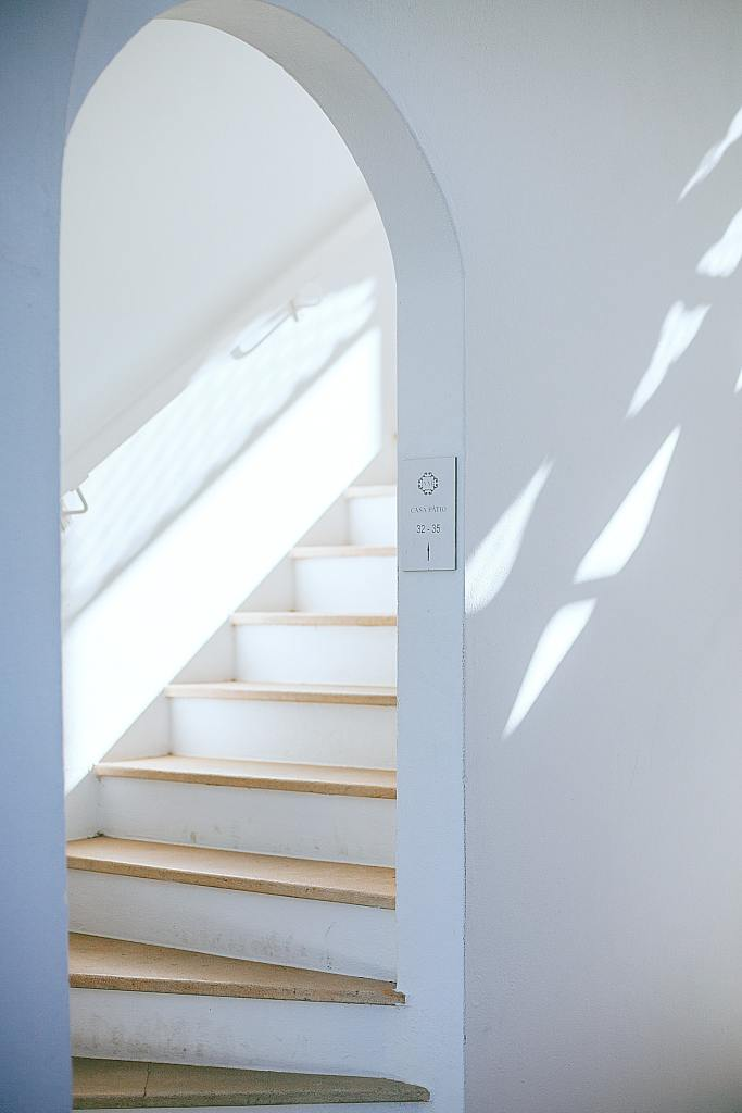 Archway with stairs leading to a loft bedroom