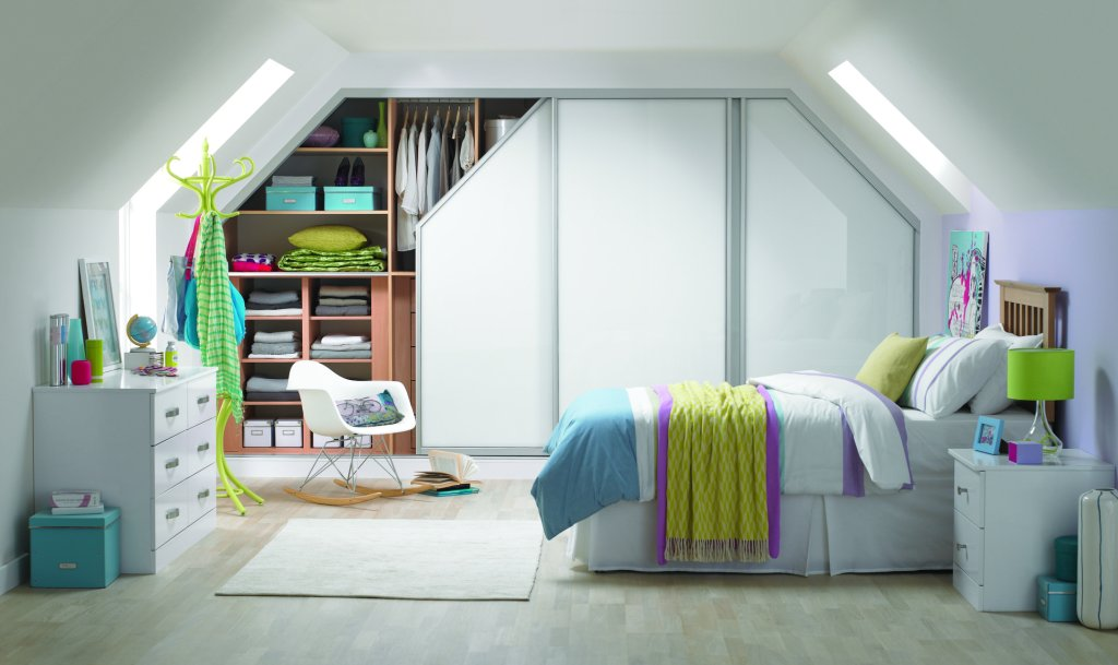 Large sliding wardrobe built into a loft bedroom by My Fitted Bedroom specialist