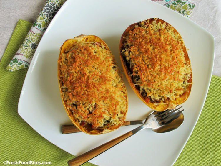 Turn spaghetti squash into a scrumptious casserole that needs no casserole dish. The squash shell doubles as the baking dish for this Chicken Sausage and Pesto Stuffed Spaghetti Squash. It's a full meal that combines cooked chicken sausage, pesto, and healthy vegetables with a crispy, crunchy panko and parmesan topper. It's delicious, loaded with vegetables, and has a super short ingredient list. Bonus!
