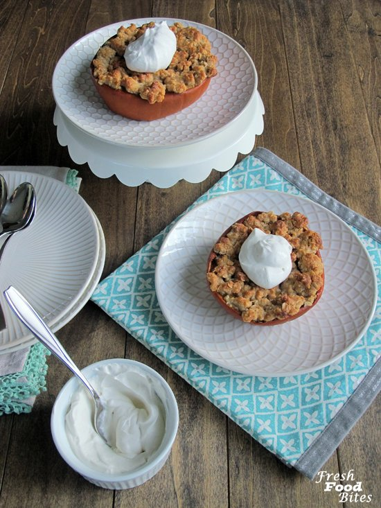 Traditional Thanksgiving pumpkin pie gets a makeover in this Streusel Topped Pumpkin Pie Stuffed Pumpkin. The pumpkin pie is stuffed inside a baked pumpkin and topped with an oatmeal streusel that is so flavorful and delightfully crumbly, you won't miss the traditional pastry. Eat the pie straight out of the pumpkin shell, or scoop out as much or as little as you want for a perfect ending to your Thanksgiving meal.