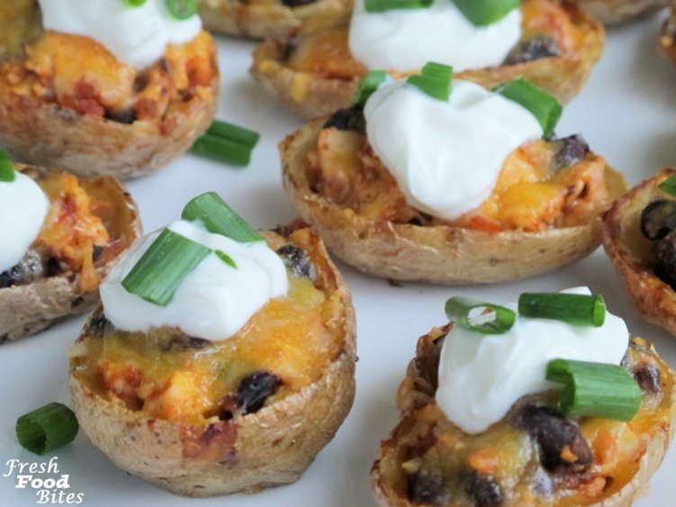 With just 6 ingredients (minus the oil and optional green onions), these 6-Ingredient Mexican Chicken Potato Skins will be a hit at your next appetizer party. They are simple to make and use healthful whole ingredients, making them a better choice than many popular appetizers. Make them spicy or mild, depending on the type of salsa you use, and top them with either plain yogurt, sour cream, or guacamole. Either way, they are a winning appetizer.