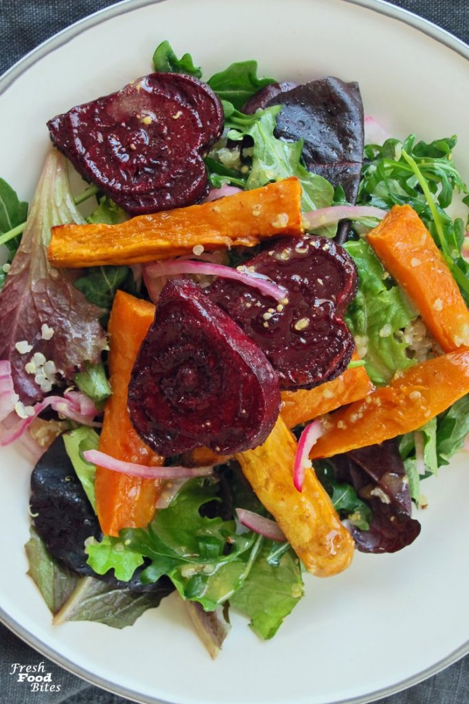 Whether you're making this festive salad for Valentine's Day or not, this Roasted Beets and Sweets Salad is full of flavor and nutrition. It pairs well with almost any main dish you like, making it a versatile salad to add to the menu of your next dinner party. Make cute heart shaped beets or skip that step for a less fussy option. Turn this salad into a main dish by tossing in some shredded cooked chicken.