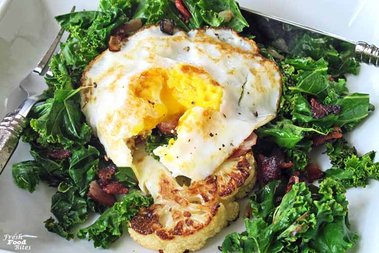 Change up your next brunch by trying this Roasted Cauliflower with Bacon, Kale and Fried Egg. This 5 ingredient brunch recipe is quick to make and is full of flavor and healthful vegetables. Or, if you're not into brunch, this tastes great for lunch or dinner too. Each of the 5 ingredients is cooked in a way that allows the most flavor to come forward, so even though the ingredient list is short, this dish is not short on flavor.