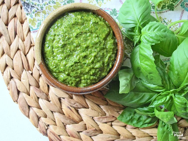 When your basil is bursting out of the garden, make this simple vegan Dairy Free Basil Pesto that has no cheese and is nut free! Even with no cheese, the flavor is full and fresh with the addition of an ingredient that mimics the salty, lightly tangy flavor of Parmesan cheese that is usually found in pesto. Use this healthy homemade pesto on pasta, chicken, fish, pizza or any other meals you love using pesto with!