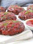 """These healthy, gluten free Grilled Mini Meat Loaves are the answer to your """"quick dinners for busy weeknight meals"""" prayers. The meat loaves only have 5 simple ingredients and the sauce takes all of 5 minutes to stir together. They are grilled rather than baked, so you can keep the heat and mess out of your kitchen. This easy recipe is one you will want to make again and again!"""