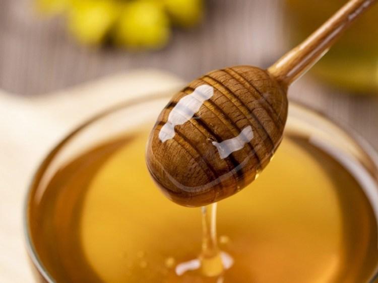 Raw honey on a stirrer