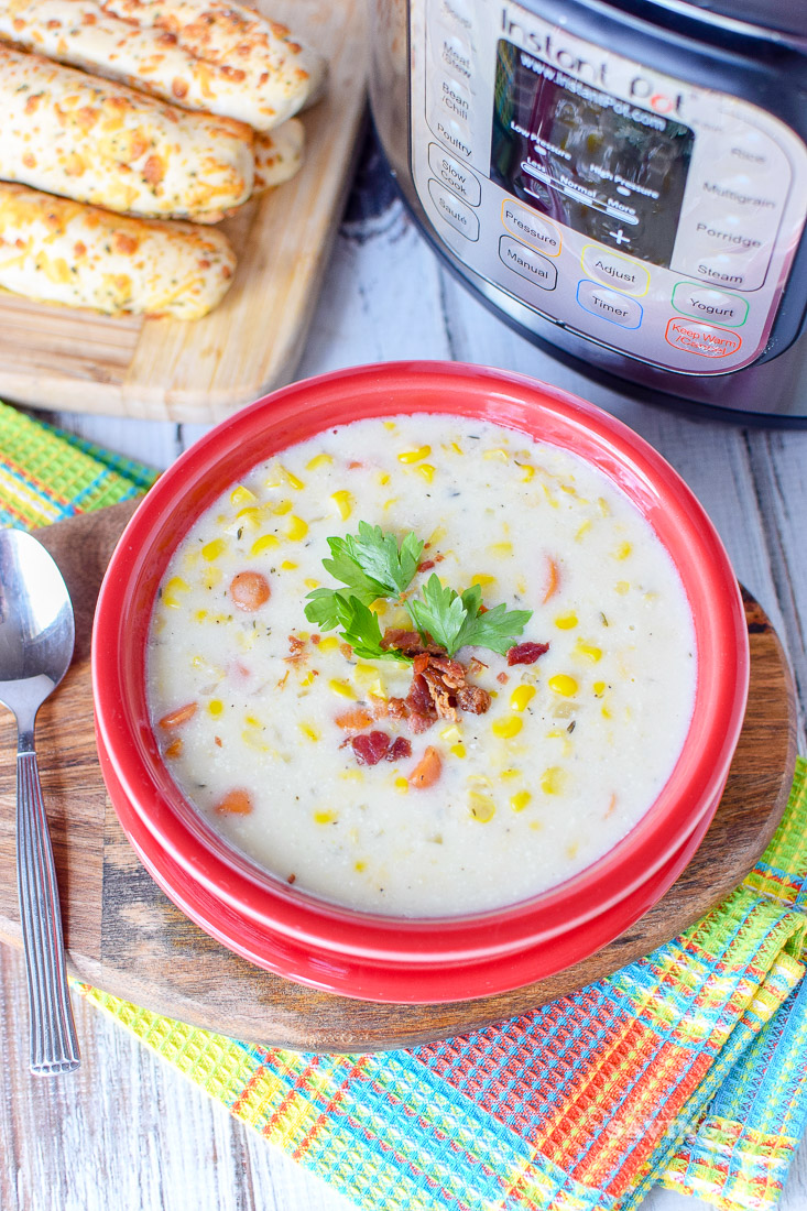 Cooler temperatures mean it is time to indulge in one of our favorite Instant Pot recipes.  This Corn Chowder Soup Recipe is super simple and full of flavor.  Any soup that is ready in minutes is going to be a favorite for this busy mom. Check out our recipe below and serve this alongside your favorite sandwich or by itself with some crusty bread!