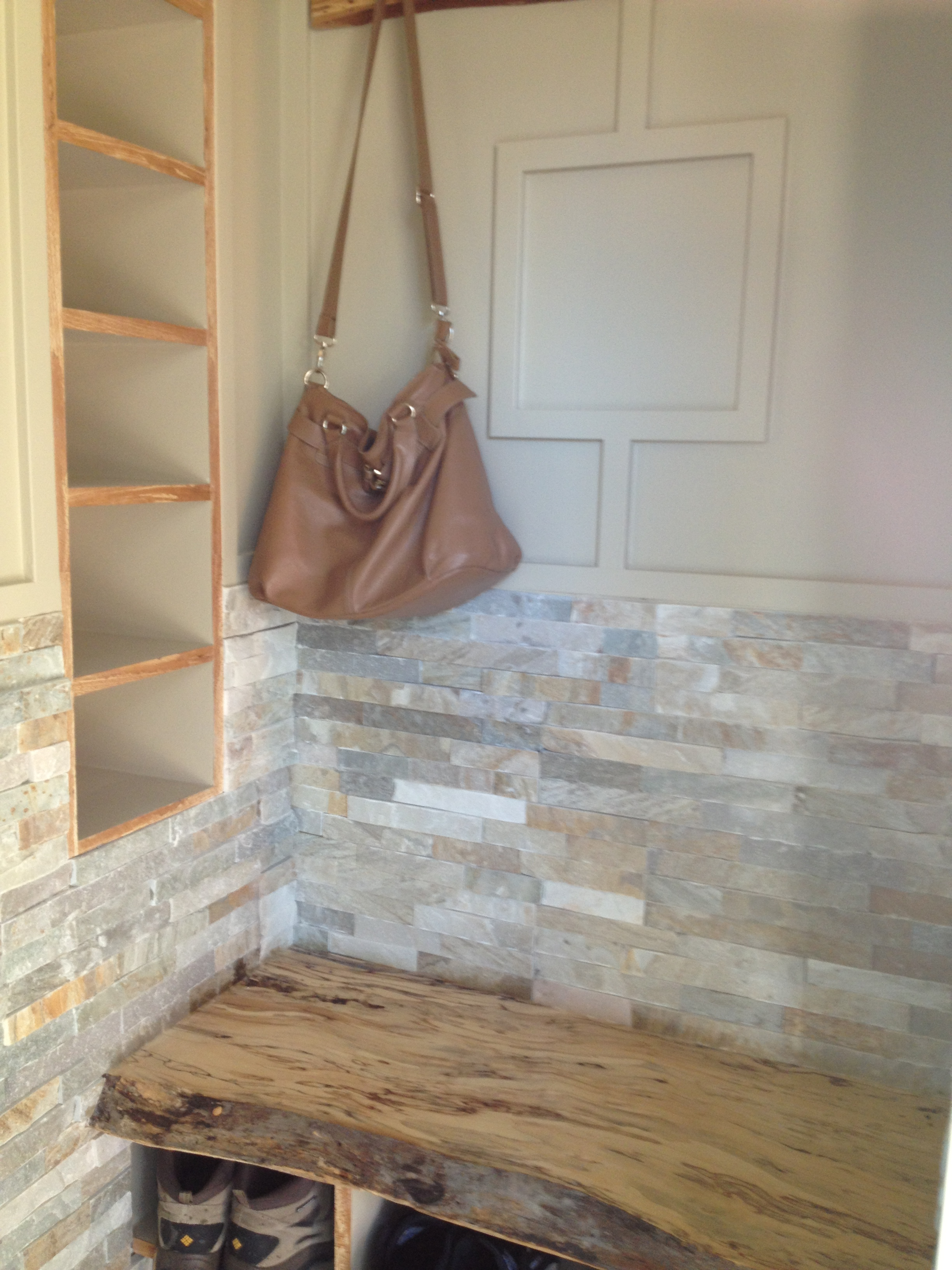 Front Entrance With Live Edge Maple Bench And Stone Walls