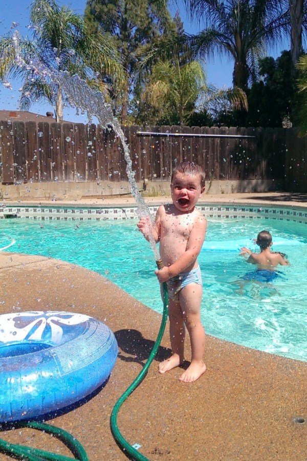 Water fun with the hose next to the pool during a hot Fresno summer afternoon! - Melissa