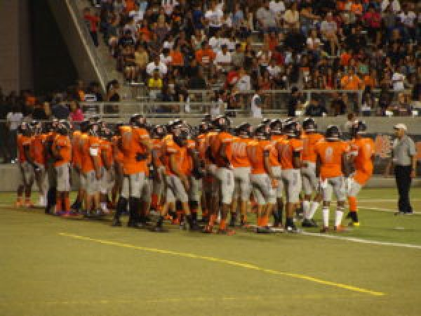 Coach Garza leading his men in orange