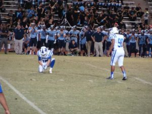 Madera kicker Evan Rios getting ready to attempt the game winning field goal