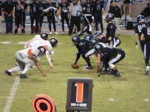 Austin Autry leading his team in a scoring drive