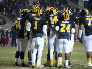 Edison in offensive huddle