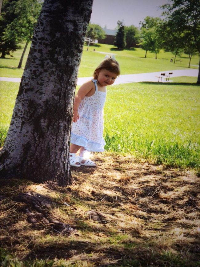 Peek-a-boo! (My daughter, about 10 years ago.)
