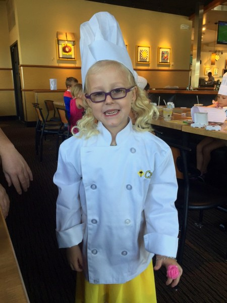 Pizza chef birthday girl in her chef's ensemble!