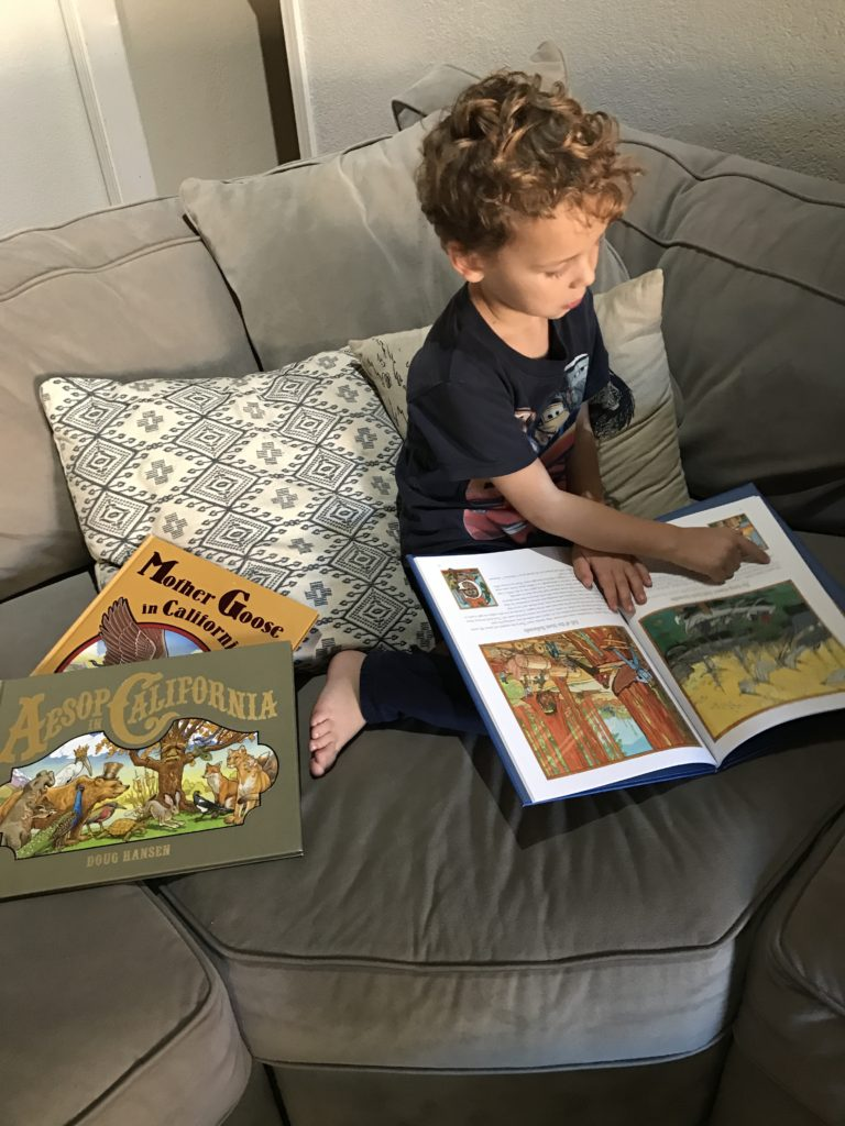 My five year old, who is learning to read, pretending to read