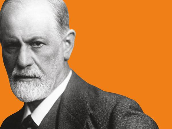 Black and white cutout photograph of Sigmund Freud set against an orange background.