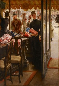 Oil painting of a young woman standing inside a shop selling ribbons and dresses.