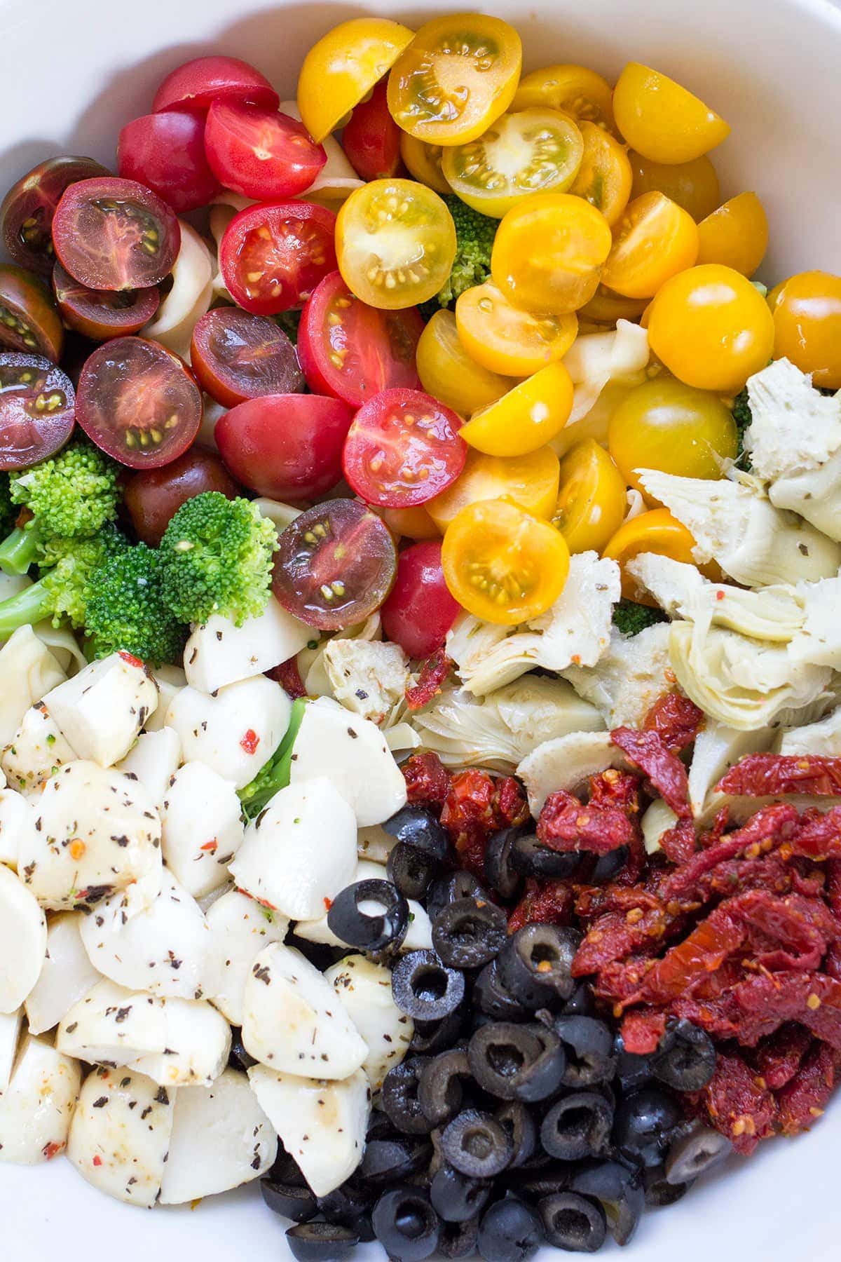 Easy Tortellini Pasta Salad with Sundried Tomatoes and Artichoke Hearts