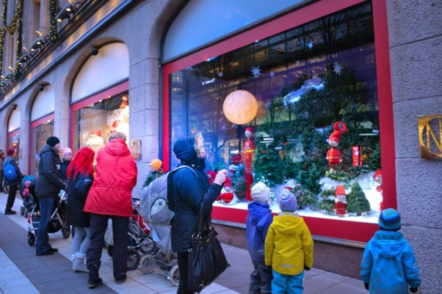 People looks at Christmas Window Display