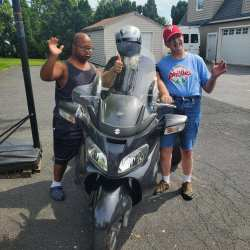 Team Member paying a special visit to Individuals on Tricycle.