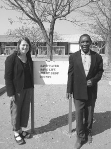 Visiting her old school in Botswana with the former head Sam Ruhube.