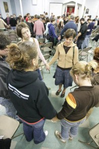 Circle of Hope members praying together. Photo courtesy of Circle of Hope.