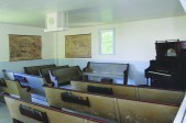 Modern side with church pews and pump organ.