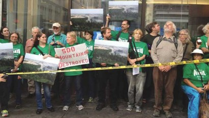 Members of Earth Quaker Action Team protest outside a PNC Bank in Manhattan.