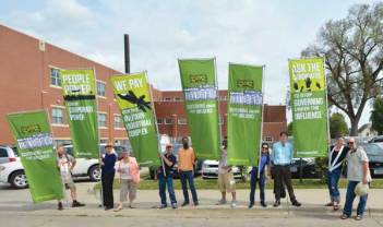 AFSC staff display GUI banners outside a Hillary Clinton town hall event in Des Moines, Iowa.