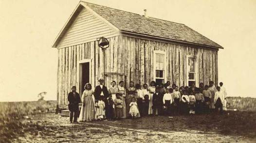 Quaker teachers, families, and students at the Ottawa School, Indian Territory, 1872. Courtesy of the Quaker Collection at Haverford College.