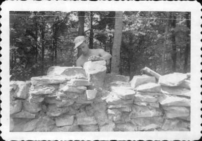 Camper building stone wall.