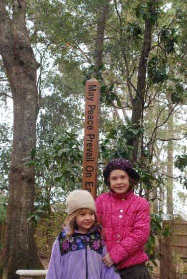 Peace pole in the garden.