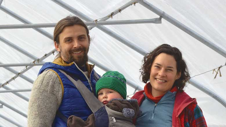 The author with his wife and child in a tent.