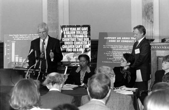 A 1994 press conference in support of the Code of Conduct for Arms Sales. Left to right; Sen. Mark Hatfield (R-OR); Rep. Cynthia McKinney (D-GA); Holly Burkhalter, director of Human Rights Watch; Joe Volk, FNCL executive secretary.