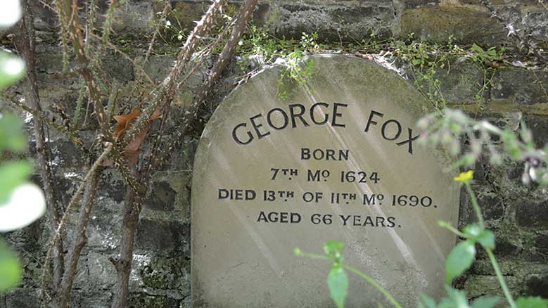 """Burial marker for George Fox in Bunhill Fields, first placed in 1881 then moved in 1952 to the meetinghouse garden wall. """"11 Month 1690"""" is January 1691 in the modern calendar. © Matt Brown, flickr.com/londonmatt"""