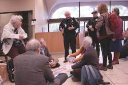 Faith Action Climate Team members in Chase Bank getting arrested to protest Chase's funding of the Dakota Access Pipeline.